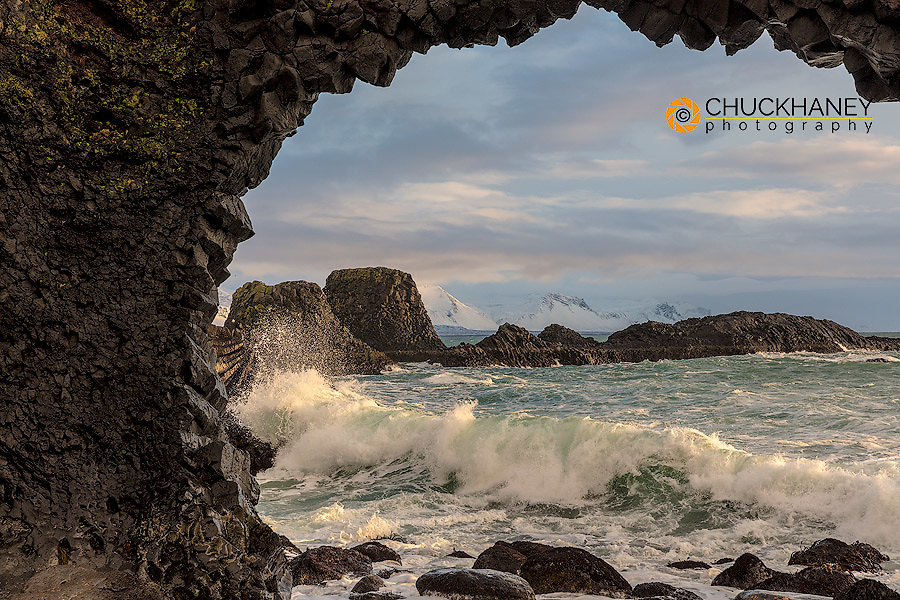 Waves crash beneath basalt sea arch on the North Atlantic ocean at Arnarstapi on the Snaefellsnes Peninsula in western Iceland