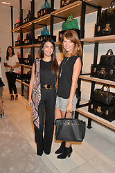 Left to right, LOHRALEE ASTOR and GABRIELLA PEACOCK at a lunch hosted by Alice Naylor-Leyland and Tamara Beckwith in celebration of the Coach 2015 collection held at Coach, New Bond Street, London on 18th September 2014.