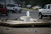 A toilet sits on the median at the intersection of Texas Avenue (Hwy 87) and Lake Street in Bridge City, Texas, Thursday September 18, 2008.  Heavy flood damage was sustained throughout the city.