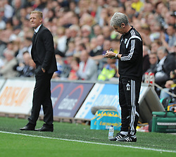 West Bromwich Albion Manager, Alan Irvine takes notes during the first half. - Photo mandatory by-line: Alex James/JMP - Mobile: 07966 386802 30/08/2014 - SPORT - FOOTBALL - Swansea - Liberty Stadium - Swansea City v West Brom - Barclays Premier League