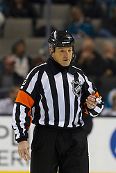 Dec 15, 2011; San Jose, CA, USA; NHL referee Tim Peel (20) before a face off between the San Jose Sharks and the Colorado Avalanche during the second period at HP Pavilion.  San Jose defeated Colorado 5-4. Mandatory Credit: Jason O. Watson-US PRESSWIRE