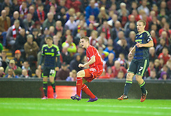 LIVERPOOL, ENGLAND - Tuesday, September 23, 2014: Liverpool's Jordan Rossiter scores the first goal against Middlesbrough on his debut during the Football League Cup 3rd Round match at Anfield. (Pic by David Rawcliffe/Propaganda)