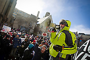 "MADISON, WI — FEBRUARY 13, 2015: UW-Milwaukee Professor of English Lane Hall rallies the crowd during the ""Stop the Cuts"" Rally on Library Mall, Saturday, February 14, 2015. The rally drew hundreds of student, faculty and community supporters in spite of the cold Midwest weather."