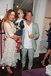ALICE TEMPERLEY and LARS VON BENNIGSEN with their son FOX VON BENNIGSEN at the Frocks and Rocks party hosted by Alice Temperley and Jade Jagger at Temperley, Bruton Street, London on 25th April 2013.