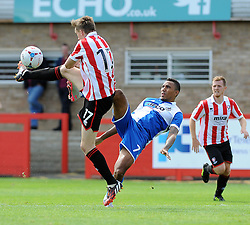 Christian Montano of Bristol Rovers challenges Daniel Parslow of Cheltenham Town - Mandatory by-line: Neil Brookman/JMP - 25/07/2015 - SPORT - FOOTBALL - Cheltenham Town,England - Whaddon Road - Cheltenham Town v Bristol Rovers - Pre-Season Friendly