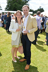 MARCUS WAREING and his wife JANE at the Cartier hosted Style et Lux at The Goodwood Festival of Speed at Goodwood House, West Sussex on 29th June 2014.