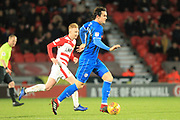 MJ Williams brings the ball forward  during the EFL Sky Bet League 1 match between Doncaster Rovers and Rochdale at the Keepmoat Stadium, Doncaster, England on 1 January 2019.