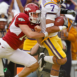 November 25, 2011; Baton Rouge, LA, USA;  Arkansas Razorbacks punter Dylan Breeding (14) LSU Tigers cornerback Tyrann Mathieu (7) as he crosses the goalline for a touchdown on a punt return during the second quarter of a game at Tiger Stadium.  Mandatory Credit: Derick E. Hingle-US PRESSWIRE