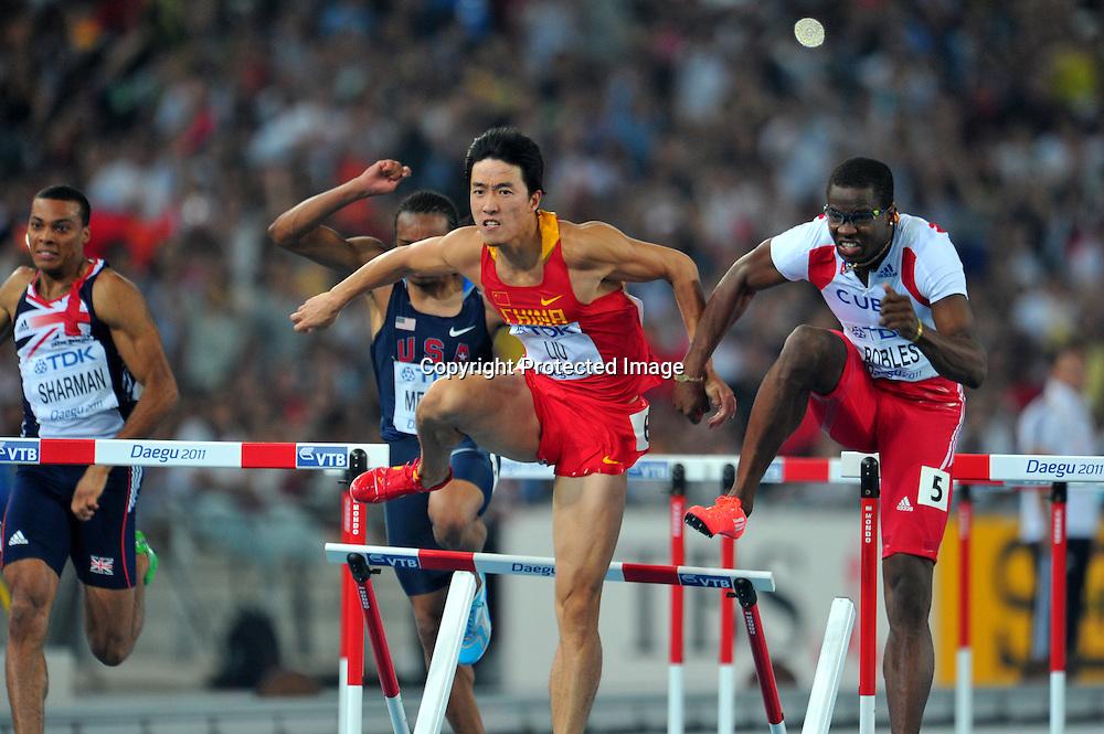 (L to R) Liu Xiang (CHN), Dayron Robles (CUB), AUGUST 29, 2011 - Athletics :The 13th IAAF World Championships in Athletics - Daegu 2011, Men's 110m Hurdles Final at the Daegu Stadium, Daegu, Korea. (Photo by Jun Tsukida/AFLO SPORT) [0003]