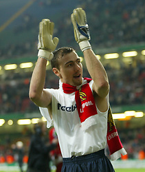 CARDIFF, WALES - Sunday, March 2, 2003: Liverpool's man-of-the-match Jerzy Dudek celebrates winning the League Cup after beating Manchester United 2-0 during the Football League Cup Final at the Millennium Stadium. (Pic by David Rawcliffe/Propaganda)