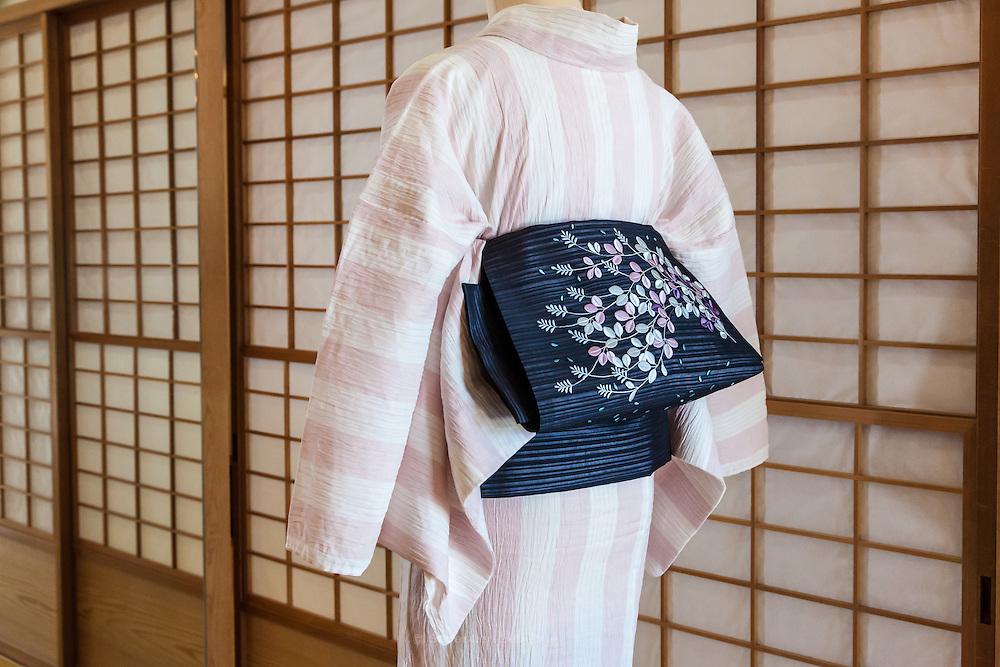 JAPAN, TOKYO -  Kururi Kimono , Sriped pink and white Kimono , Black obi with purple flowers - from the shop Kururi in Omotesando - 06-2014