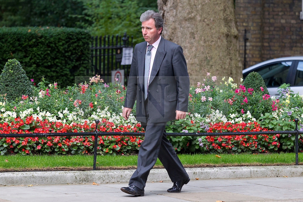 © Licensed to London News Pictures. 23/09/2013. London, UK. On the day of an emergency meeting of the COBRA committee to discuss the recent Kenyan terrorist attack Oliver Letwin, Minister of State at the Cabinet Office, is seen on Downing Street today (23/09/2013) with a British Army General. Photo credit: Matt Cetti-Roberts/LNP