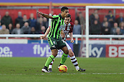 Lyle Taylor of AFC Wimbledon holds the ball up during the Sky Bet League 2 match between Exeter City and AFC Wimbledon at St James' Park, Exeter, England on 28 December 2015. Photo by Stuart Butcher.