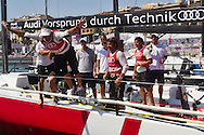ITALY, Sardinia, Cagliari. 24th July 2011. AUDI MedCup. Jochen Schumann, skipper of winning team Audi Sailing Team powered by ALL4ONE dives into the water.