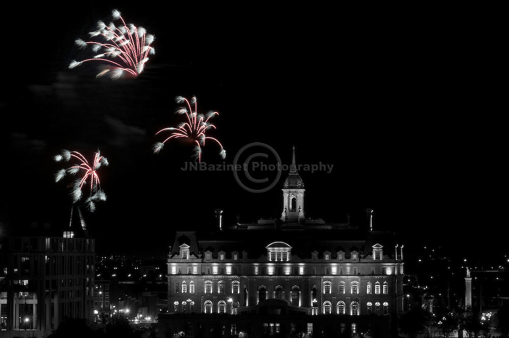 Fireworks celebrating the Tall Ships; City Hall in Old Montreal, QC