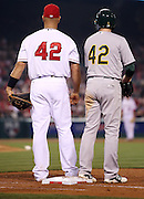 ANAHEIM, CA - APRIL 15:  Albert Pujols #5 of the Los Angeles Angels of Anaheim and Jed Lowrie #8 of the Oakland Athletics wear #42 jerseys during the game against the Oakland Athletics at Angel Stadium on Tuesday, April 15, 2014 in Anaheim, California. The Athletics won the game 10-9 in eleven innings. (Photo by Paul Spinelli/MLB Photos via Getty Images) *** Local Caption *** Albert Pujols;Jed Lowrie