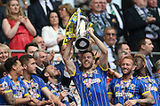Jon Meades lifting the trophy after Wimbledon win the Sky Bet League 2 play off final match between AFC Wimbledon and Plymouth Argyle at Wembley Stadium, London, England on 30 May 2016.