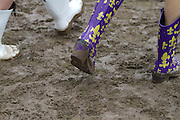 Festival goers dance walk through mud at the New Orleans Jazz Festival. ©Kathy Anderson, All Rights Reserved