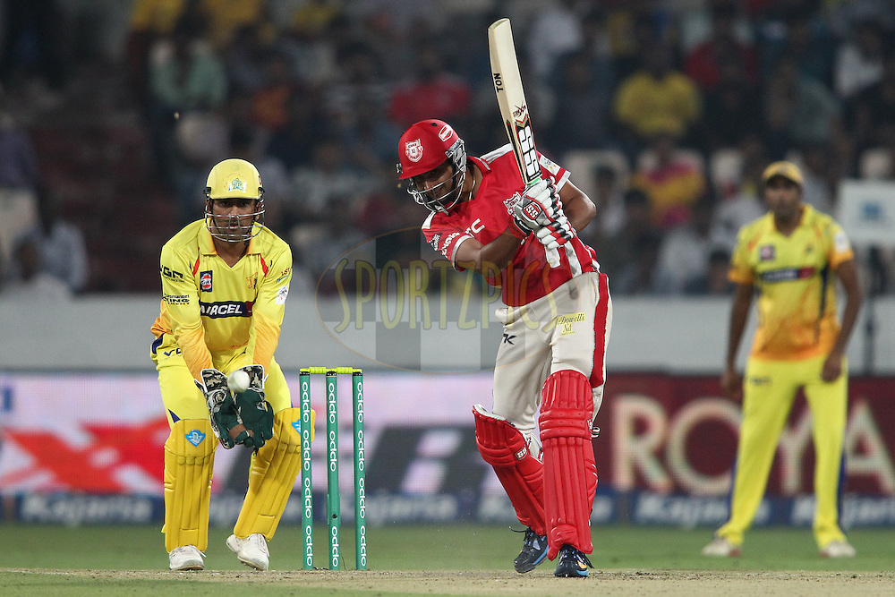 Karanveer Singh of the Kings XI Punjab drives a delivery during the second semi final match of the Oppo Champions League Twenty20 between the Kings XI Punjab and the Chennai Superkings held at the Rajiv Gandhi Cricket Stadium, Hyderabad, India on the 2nd October 2014<br /> <br /> Photo by:  Shaun Roy / Sportzpics/ CLT20<br /> <br /> <br /> Image use is subject to the terms and conditions as laid out by the BCCI/ CLT20.  The terms and conditions can be downloaded here:<br /> <br /> http://sportzpics.photoshelter.com/gallery/CLT20-Image-Terms-and-Conditions-2014/G0000IfNJn535VPU/C0000QhhKadWcjYs