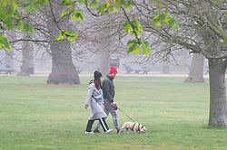 © Licensed to London News Pictures. 07/04/2019.<br /> Greenwich, UK.Sunday morning dog walkers, A foggy damp morning in London and the South East as people are out and about in Greenwich Park, Greenwich, London.  Photo credit: Grant Falvey/LNP