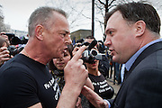 Ed Ball MP faces a heated grilling from a protester at the  TUC March for the Alternative 26 March 2011