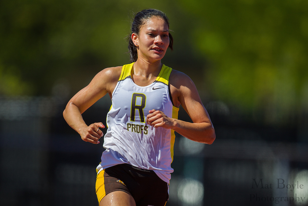 Rowan University senior Vanessa Wright wins the women's 10,000 meters at the NJAC Track and Field Championships at Richard Wacker Stadium on the campus of  Rowan University  in Glassboro, NJ on Saturday May 4, 2013. (photo / Mat Boyle)