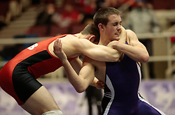 London, Ontario ---2013-03-02--- J. F. Godin of The University Of New Brunswick takes on Ethan Smith of Western in the men's 61 KG 5th/6th match at the 2012 CIS Wrestling Championships in London, Ontario, March 02, 2013. .GEOFF ROBINS/Mundo Sport Images