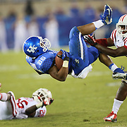 September 15, 2012 - Lexington, Kentucky, USA - UK's JONATHAN GEORGE gains a first down as he was tackled by WKU's KIANTE YOUNG, right, late in the second half as Western Kentucky University defeated the University of Kentucky, 32-31, on a trick play in overtime. (Credit Image: © David Stephenson/ZUMA Press).