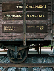 June 30, 2017 - Whitwell, Tennessee, U.S. -  The Children's Holocaust Memorial at the Whitwell Middle School.  In 1998, when students of Whitwell Middle School were having difficulty grasping the enormity of the number of Jews exterminated in the Holocaust, but having learned that Norwegians often wore paper clips as a silent expression of protest against Nazi occupation and solidarity with the Jews, one of the students suggested that the school should try to collect six million paper clips, one for each victim.  After several years of collecting paper clips from all 50 states and all seven continents, their goal was met and exceeded.  An actual German rail car used to transport people to the concentration camps was secured, and there are now 11 million paper clips inside the rail car, and another 11 million honoring the children who died in the Holocaust housed  inside the monument that stands beside it.  The butterflies on the grounds are a Christian symbol of renewal and of the Children of Terezin.(Credit Image: © Brian Cahn via ZUMA Wire)