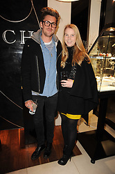 Left to right, designers HENRY HOLLAND and KATIE HILLIER at a party for TACH jewellery held at Tach, 13 Grafton Street, London on 10th December 2009.