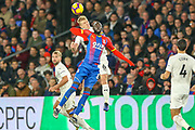 Crystal Palace midfielder Cheikhou Kouyate (8) and Burnley defender Ben Mee (6) in the air during the Premier League match between Crystal Palace and Burnley at Selhurst Park, London, England on 1 December 2018.