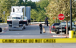 July 23, 2017 - San Antonio, TEXAS, USA - Law enforcement at the scene, where people were discovered inside a tractor trailer in a Walmart parking lot at IH35 South and Palo Alto Road, Sunday. Reports say that 8 were dead and several were in critical condition. (Credit Image: © San Antonio Express-News via ZUMA Wire)