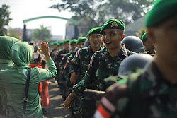 September 29, 2018 - Bogor, West Java, Indonesia - Families of the Indonesian Army welcomed the return of 450 soldiers belonging to the Border Supervisory Unit (Pamtas Task Force) 315 / Garuda Battalion who had carried out the state's duty to secure the borders of the Republic of Indonesia and Papua New Guinea were welcomed with a traditional ceremony at the headquarters of Yonif 315 / Garuda, Bogor, West Java , Indonesia. (Credit Image: © Adriana Adinandra/Pacific Press via ZUMA Wire)