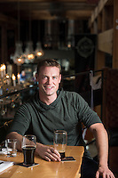 Sean Bruce, a naval officer in Victoria, BC, enjoys a beer at Canoe Brewpub as one of his favorite places.