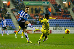James Perch of Wigan shoots past Jacques Maghoma of Sheffield Wednesday - Photo mandatory by-line: Rogan Thomson/JMP - 07966 386802 - 30/12/2014 - SPORT - FOOTBALL - Wigan, England - DW Stadium - Wigan Athletic v Sheffield Wednesday - Sky Bet Championship.