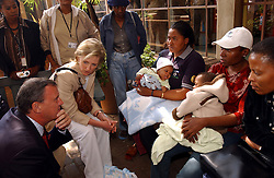 JOHANESBURG, SOUTH AFRICA - APRIL-28-2004 -&#xA;Princess Astrid of Belgium and Marc Verwilghen , Belgian Minister of Development and Cooperation, talk to mothers who are HIV positive and have transmitted the disease to their babies during birth at the Chris Hani Aragwanath Hospital in the Soweto Township of Johanesburg . (PHOTO © JOCK FISTICK)&#xA;&#xA;&#xA;<br />