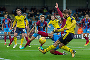 Scunthorpe United defender Jordan Clarke slides in and blocks a shot from Oxford United midfielder Ricky Holmes during the EFL Sky Bet League 1 match between Scunthorpe United and Oxford United at Glanford Park, Scunthorpe, England on 3 November 2018.
