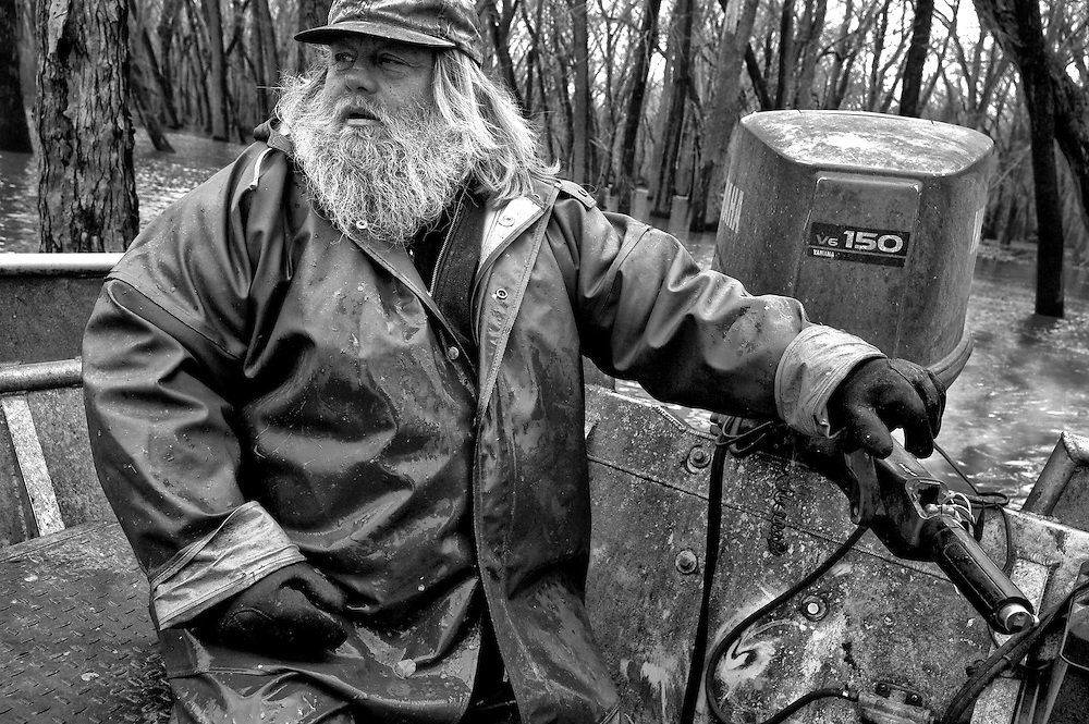 Commercial fisherman Orion Briney works the backwaters of the Illinois River. Briney primarily harvest Asian carp.