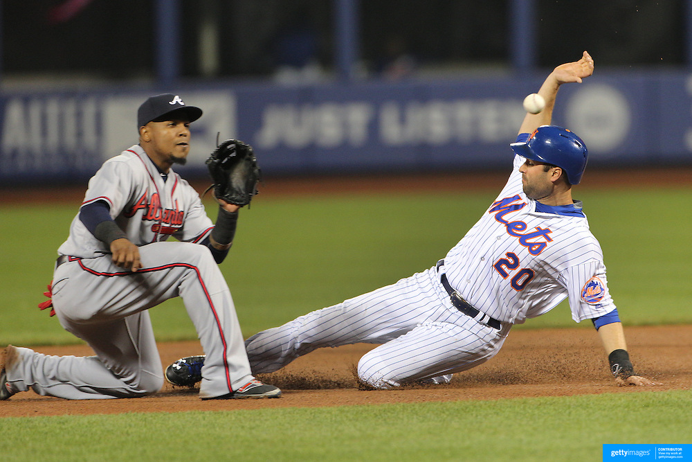 NEW YORK, NEW YORK - MAY 02:  Neil Walker #20 of the New York Mets steals second base as Erick Aybar #1 of the Atlanta Braves prepares to catch the ball during the Atlanta Braves Vs New York Mets MLB regular season game at Citi Field on May 02, 2016 in New York City. (Photo by Tim Clayton/Corbis via Getty Images)