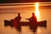 Men fishing from canoe