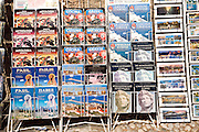 Postcards and guide books in display rack, Rhodes, Greece
