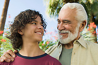 Boy (13-15) with Grandfather outdoors front view.