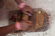 Curry Paste is being grind from fresh ingredients to use for the Wedding meal. Varanasi, India.