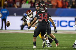 SANTA CLARA, CA - DECEMBER 05:  Quarterback Cody Kessler #6 of the USC Trojans fumbles after getting hit by linebacker Blake Martinez #4 of the Stanford Cardinal during the third quarter of the Pac-12 Championship game at Levi's Stadium on December 5, 2015 in Santa Clara, California. The Stanford Cardinal defeated the USC Trojans 41-22. (Photo by Jason O. Watson/Getty Images) *** Local Caption *** Cody Kessler; Taijuan Thomas