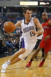 November 1, 2010; Sacramento, CA, USA;  Sacramento Kings power forward DeMarcus Cousins (15) dribbles past Toronto Raptors point guard Jarrett Jack (1) during the first quarter at the ARCO Arena.