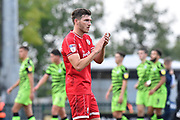 Jordan Tunnicliffe (19) of Crawley Town applauds the travelling fans at full time after the 3-1 loss during the EFL Sky Bet League 2 match between Forest Green Rovers and Crawley Town at the New Lawn, Forest Green, United Kingdom on 5 October 2019.