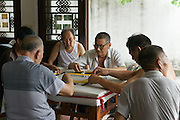 Men playing the Chinese game Mahjong. This game was banned by the government of People's Republic of China when it took power in 1949. After the Cultural Revolution, the game was revived, without gambling elements , and the prohibition was revoked in 1985. Today, it is a favorite pastime in China and other Chinese-speaking communities.