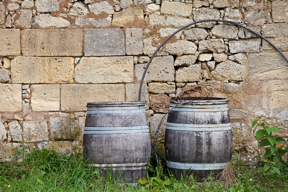 Traditional old wine barrels at a wine chai near St Emilion, Bordeaux, France