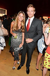 IRENE FORTE and JACOBI ANSTRUTHER-GOUGH-CALTHORPE at the Tatler & Christie's Art Ball held at Christie's, 7-15 Ryder Street, London on 12th June 2014.