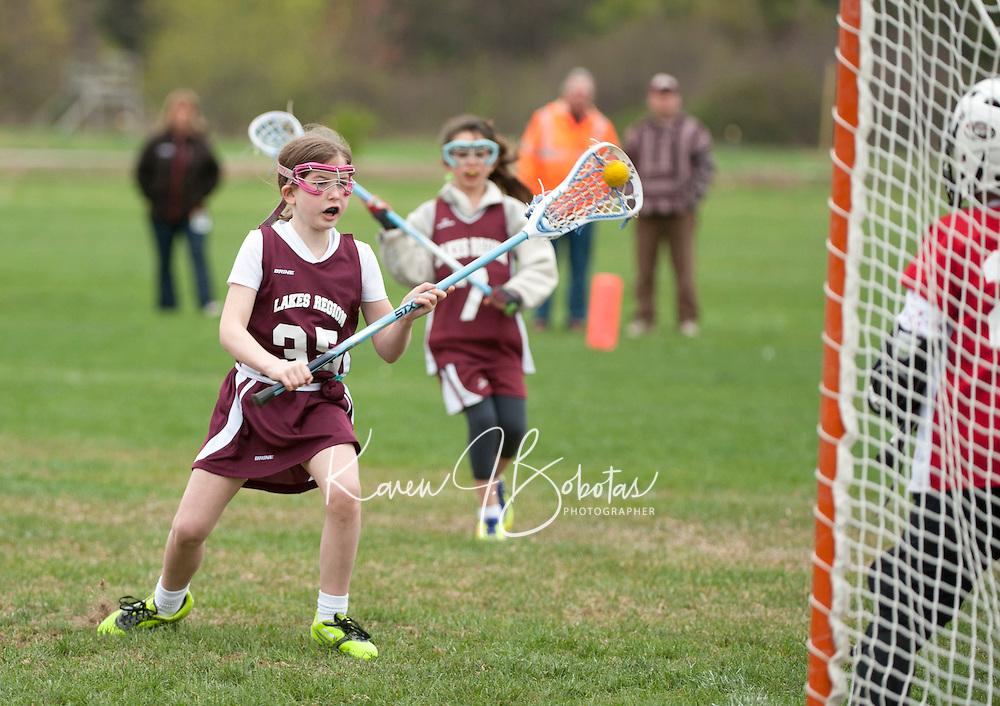 Lakes Region Lacrosse versus Oyster River U11 girls game Saturday, April 22, 2012.
